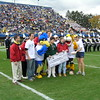 2006 Pigskin Pass : The Pigskin Pass is a 58-mile relay run between Towson University and the University of Delaware where student-athletes from each school carry a special game ball to be delivered right before kick-off of the football game between the two schools. Along with heightening attention to the football rivalry between Towson and Delaware, participating Pigskin Pass runners are also raising awareness and financial support for Special Olympics, with all proceeds from the run going to Special Olympics Delaware and Special Olympics Maryland.