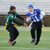 Middletown's #11 Dalton Johnson runs with the ball in their game against Mt. Pleasant in the DIAA/Special Olympics Delaware Unified flag football game at the University of Delaware.