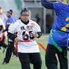 William Penn's #66 Danielle Alphonse rushes Caesar Rodney's quarterback in the DIAA/Special Olympics Delaware Unified flag football game at the University of Delaware.