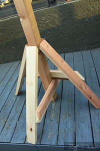 Legs are stabilized with cross support that are easily taken apart.