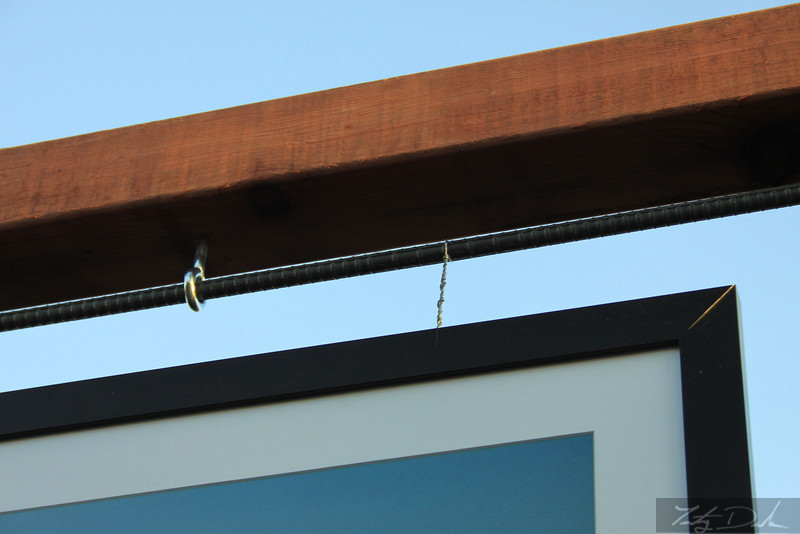 Its easy to hang any type of art from the cross beam.