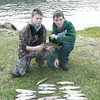 Mason and Jake Woody show of their trout they snagged while fishing with Greg Jones along Norris Dam.