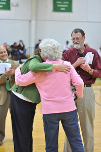 Betty Thompson receiving certificate for Coach Butch Thompson as Mr. Houston Raby and Mr. Scott Mason looks on.