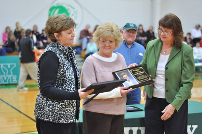 Barbara Berwanger and Vivian Kittle (Mrs. Allie's daughters) receiving certificate and plaque for Mrs. Allie Howard - Midway Hall of Fame inductee.