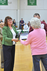 Cindy Rose Jones presenting certificate to Betty Thompson for Coach Butch Thompson.
