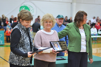 Barbara Berwanger and Vivian Kittle (Mrs. Allie's daughters) receiving certificate and plaque for Mrs. Allie Howard - Midway Hall of Fame inductee as Alton Lingerfelt and Cindy Rose Jones listen as Mr. Boyd Woody shares memories of Mrs. Allie.