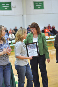Cindy Rose Jones presenting certificate to Shannon Edgemon Hill as Missy Edgemon Guettner looks on.