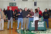 Cindy Jones presents plaque honoring inductee - Mr. Stanley Galyon - Mathematics Teacher and Boys Basketball Coach at Midway High School for 25 years to Lewis Galyon - Mr. Galyon's son as (L to R) Ron Woody, Archie Edgemon, Jerry Walker, Keevin Woody, Wade Ray, and Wade Rucker - former students/basketball players look on.