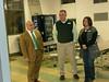 Scott Mason (Midway High School principal) visting with Jonathan & Missy Edgemon