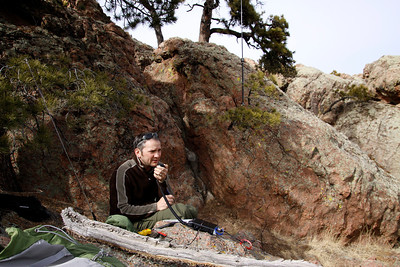 "Buddistick vertical set up in background for 20 meters, using the smallest coil, 2 11"" arms and a stainless whip.  I was able to drape the ground radial over rock with no problem."