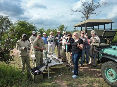 the full safari group takes a morning coffee break  ( two land rovers)
