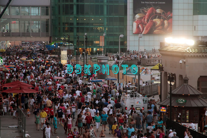 ATLANTIC CITY, NJ - JULY 04:  Crowds line boardwalk waiting for 4th Of July Concert And Firework Celebration at Kennedy Plaza on July 4, 2012 in Atlantic City, New Jersey.