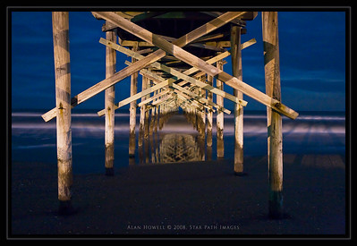 Underneath the Ocean Isle Beach pier. This photo was taken around 3am using a very long exposure and a chilled Canon camera to reduce camera 'noise'.