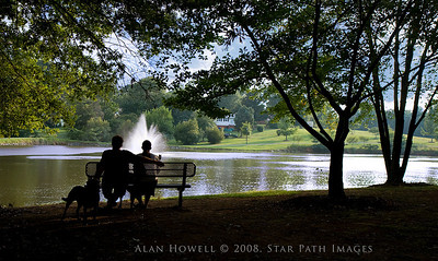 A couple enjoying a pause at Roosevelt Wilson Park in the quaint town of Davidson NC near Lake Norman.