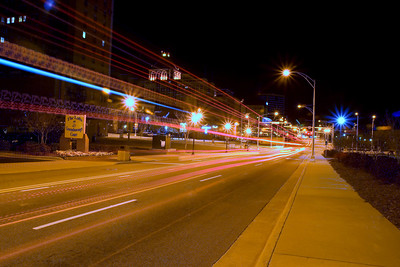 Long exposure taken of a city bus cruising down Davie Street in Greensboro NC. If you look closely, you can see how many times the camera senses the image during the exposure in the tail light 'tracers'.