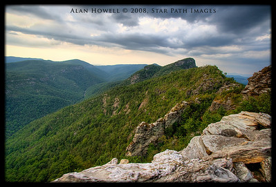 Storm clouds rolling over Hawksbill and Table Rock in the Linville Gorge area. This is a 5 photo stack HDR (high dynamic range) photo with added enhancement to bring out the details in the sky and rocks.