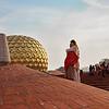 АУРОВИЛЬ<br /> <br /> Бег волн Индийский океан <br /> Стремит к Тамильским побережьям.<br /> Там людям всем из разных стран – <br /> Любви Ковчег, Земля Надежды.<br /> Здесь, Солнца ярче, в сини неба <br /> Горит Сверхразума звезда<br /> И Белоснежный Город Света <br /> Расправил крылья-паруса!<br /> <br /> Ауровиль – к Тебе весь зов надежды мира!<br /> Ауровиль – сверкает шар Матримандира!<br /> Ауровиль – в нём блеск Рождения огня!<br /> Здесь Мать и Шри Ауробиндо <br /> Мир на Земле Божественный творят!<br /> <br /> С Ним духом воедино слит, <br /> В какой бы ни бывать мне дали.<br /> Иду по улицам Твоим <br /> Как по галактики спирали<br /> И, Золотом, Матримандир <br /> Расцветит разум клеток сонных,<br /> Явив Божественного Мир, <br /> В сознаньях многомиллионных!<br /> <br /> Звучанием извечным – ОМ! <br /> Пространств поющих свяжут струны<br /> Единой радугой златой<br /> Сердец таинственные руны.<br /> И Белый Свет, Извечный Свет <br /> Чрез Шар Хрустальный возгорится!<br /> Дав счастье душам всех существ<br /> В Нём Сверхдушою возродиться!<br /> <br /> Ауровиль – Ты есть Корабль Супраментальный!<br /> Ауровиль – нам всем Маяк, Твой Шар Хрустальный!<br /> Ауровиль – улыбкой Матери парит!<br /> И Свет Божественной Зари<br /> Пылает Солнцем утренним, Твоим!<br /> <br /> Тенистый храм Твоих лесов – <br /> Богов прибежище в Нирване.<br /> Здесь клады мантр, волшебных строф, <br /> Хранятся в Савитри Бхаване.<br /> Но что сокровищ всех на свете<br /> Ценней здесь, на земле тамильской?<br /> То Матери Вселенской дети – <br /> Твои жильцы, Ауровильцы!<br /> <br /> Их руки Мир Богов творят!<br /> Их смех – Всевышнего беспечность!<br /> Таят Божественный наряд <br /> Их скромность, труд и человечность!<br /> Творцы прекрасных нив, лесов – <br /> Смирились им стихии злые,<br /> В Деснице Матери Миров – <br /> То Инструменты Золотые!<br /> И мало сердцу бренных слов – <br /> Воспеть Рассвета Город Дивный,<br /> Из Логоса Извечных Строф <br /> Сознанья Шри Ауробиндо!<b