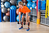 dumbbell deadlift blond man at gym weightlifting