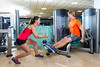 Calf extension man at gym exercise machine