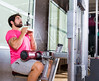 Cable Lat pulldown machine man workout at gym