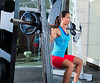 girl squats in multipower squatting smith machine
