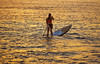 SUP Stand up Surf girl with paddle