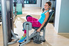 Hip abduction woman exercise at gym indoor