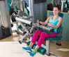 Gym seated leg curl machine exercise woman