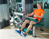 Gym seated leg curl machine exercise blond man