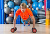 Blond man gym push-up pushup dumbbells