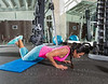 brunette woman at gym knees push up push-up
