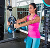 front plate raise brunette girl workout at gym exercise