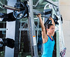 brunette girl in multipower barbell at gym smith