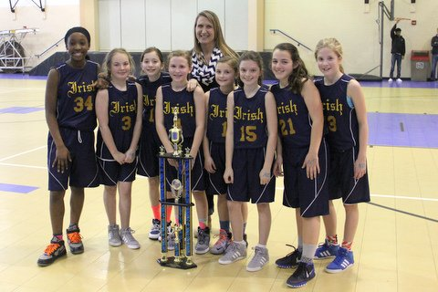 Coach Candy VanBuskirk with 6th grade girls basketball team.