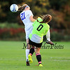 Winnacunnet's #21 Caroline Meuse and Spaulding's Goal Keeper Monica Harris collide during a Winnacunnet shot on the goal during Friday's Winnacunnet Girls Varsity Soccer game vs Spaulding High School on  10-10-2014 @ WHS.  Matt Parker Photo