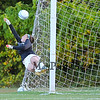 Winnacunnet's Goal Keeper Emily Parks dives for a Spaulding kicked ball during Friday's Winnacunnet Girls Varsity Soccer game vs Spaulding High School on  10-10-2014 @ WHS.  Matt Parker Photo