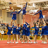 Winnacunnet's Megan Cico, Kristen Immoor, Carly Birch are lifted into a pyramid extension during Sunday's 2014 NHIAA Division II Fall Spirit Championships at Pinkerton Academy on 11-9-2014.  Matt Parker Photo