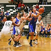 Winnacunnet's #14 Meg Knollmeyer looks to the hoop for a basket with Dover's #11 Cheyenne Garcia defending during Friday Night's Girls Div I Basketball game between Winnacunnet and Dover High Schools on 12-12-2014 @ Dover.  Matt Parker Photos