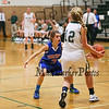 Winnacunnet's #3 Kelly Arsenault plays defense on Dover's #12 Abigail Cooke during Friday Night's Girls Div I Basketball game between Winnacunnet and Dover High Schools on 12-12-2014 @ Dover.  Matt Parker Photos