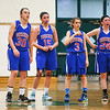 Winnacunnet Girls Basketball Players (L to R) Casey Maggiore, Katie Valcich, Kelly Arsenault and Molly Britton stand at mid court while teammate  #14 Meg Knollmeyer takes technical foul shots during Friday Night's Girls Div I Basketball game between Winnacunnet and Dover High Schools on 12-12-2014 @ Dover.  Matt Parker Photos