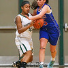 Winnacunnet's #15 Katie Valcich plays defense against Dovers #45 Sophie Roy during Friday Night's Girls Div I Basketball game between Winnacunnet and Dover High Schools on 12-12-2014 @ Dover.  Matt Parker Photos