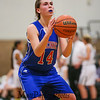 Winnacunnet's #14 Meg Knollmeyer looks to the hoop while taking foul shots on a Dover technical foul during Friday Night's Girls Div I Basketball game between Winnacunnet and Dover High Schools on 12-12-2014 @ Dover.  Matt Parker Photos