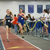 Winnacunnet's Amanda Cestrone (5:19.70-2nd) and Exeter's Emma Henricks (5:20.40-3rd) head into the 2nd to last lap of the Girls 1500 Meter Run during Saturday's NH Indoor Track and Field League Meet @ The Paul Sweet Oval, UNH on 12-21-2014.  Matt Parker Photos.