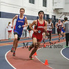 Winnacunnet's Adam Janik (4:38.40) and Pinkerton's Tyler Albano (4:41.30) at a turn in The Boys 1500 Meter Run during Saturday's NH Indoor Track and Field League Meet @ The Paul Sweet Oval, UNH on 12-21-2014.  Matt Parker Photos.