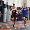 Winnacunnet's Ryan Hanley (38.70-1st) and Portsmouth's Andrew Scarlotto (39.80-3rd) are side-by-side in the Boys 300 Meter Dash during Saturday's NH Indoor Track and Field League Meet @ The Paul Sweet Oval, UNH on 12-21-2014.  Matt Parker Photos.