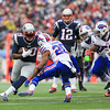 Patriots RB #29 LeGarrette Blount after getting a handoff from QB Tom Brady makes a cut to get past Buffalo's CB #20 Corey Graham during Sunday's NFL Football game between The New England Patriots and The Buffalo Bills on 12-28-2014 @ Gillette Stadium, Foxborough Mass.  Matt Parker Photos