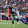 Patriots QB #10 Jimmy Garoppolo throws a pass while getting tackled by a Bill's player during Sunday's NFL Football game between The New England Patriots and The Buffalo Bills on 12-28-2014 @ Gillette Stadium, Foxborough Mass.  Matt Parker Photos