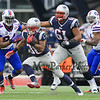 Patriots RB Brandon Bolden gets running room off a block by Patriots #61 OL Marcus Cannon on Bills DE #94 Mario Williams during the first half of Sunday's NFL Football game between The New England Patriots and The Buffalo Bills on 12-28-2014 @ Gillette Stadium, Foxborough Mass.  Matt Parker Photos