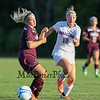 Winnacunnet's Alli Giacalone gets the ball past Timberlane Defender Maddy Kennedy during the Winnacunnet Girls Varsity Soccer game between Winnacunnet and Timberlane High Schools on Tuesday 9-16-2014 @ WHS.  Matt Parker Photo
