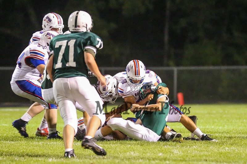 Junior #40 Cole Parker makes a tackle at the Winnacunnet Boys Varsity Football game vs Dover High School @ Dover on Friday Night 9-5-2014.  Matt Parker Photo